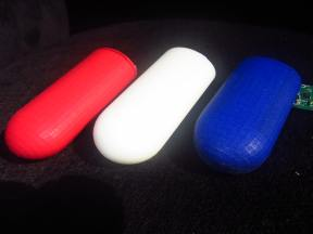 The red and blue case are printed in SLS technology, the white case in STL. The STL print has a smooth and soft surface.
